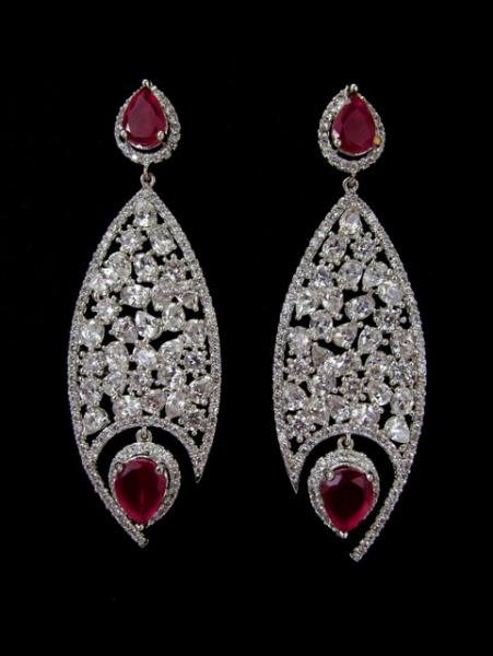 Dare to dazzle with this bejeweled/radiant/shiny earring.